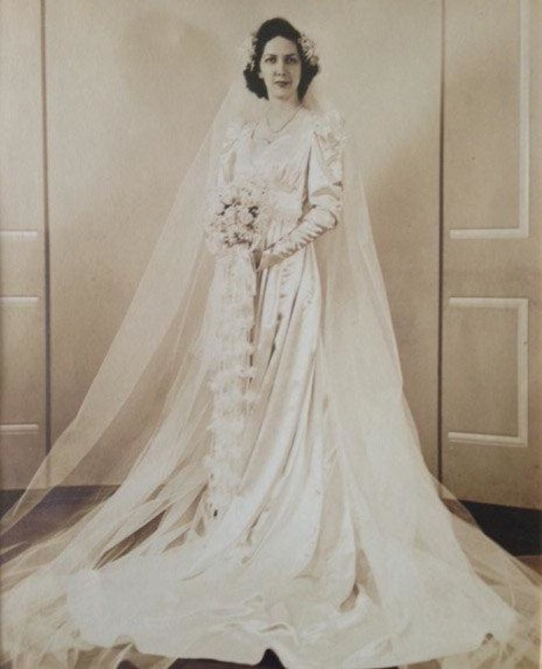 Photo - Like many wedding during World War II, Mary Love Wornom was married while her husband-to-be was home for a short leave in August 1942. But unlike most dresses during that time, Wornom wore a long sleeve satin gown with buttons down the back.