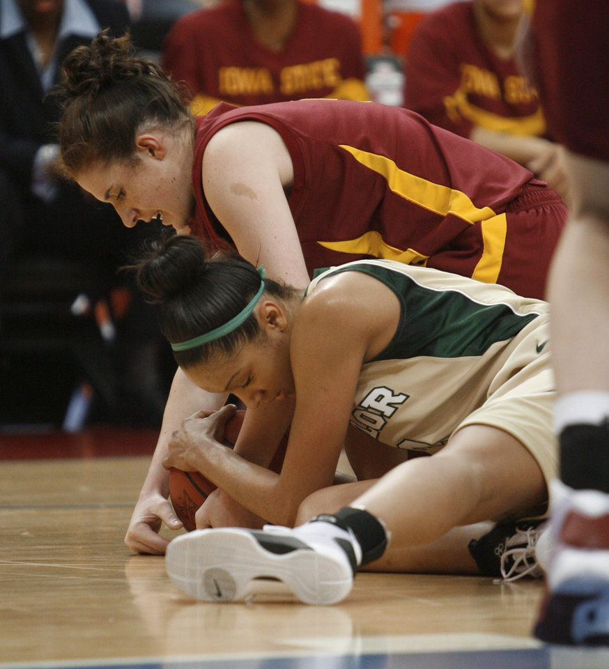 Jessica Morrow, bottom, and Allison Lacey tie for the ball during the first half of the 2009 Big 12 Women\'s Basketball Championship game between Baylor University and Iowa State in the Cox Convention Center in Oklahoma City, Oklahoma, on Saturday, March 14, 2009. PHOTO BY STEVE SISNEY, THE OKLAHOMAN