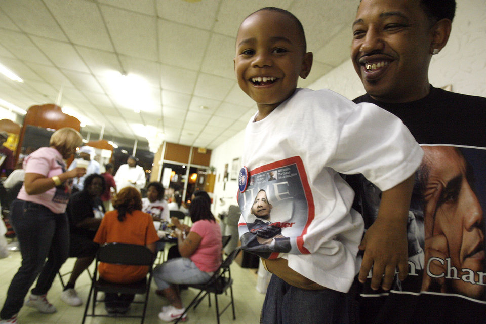 Photo - Brandon Johnson, 4, of Spencer, Okla.,  and Corey Sutter, Atoka, Okla., shows their support for Barack Obama at a watch party at the Images of Hair and Nails  salon Tuesday, Nov .4, 2008, in Oklahoma City. PHOTO BY SARAH PHIPPS, THE OKLAHOMAN