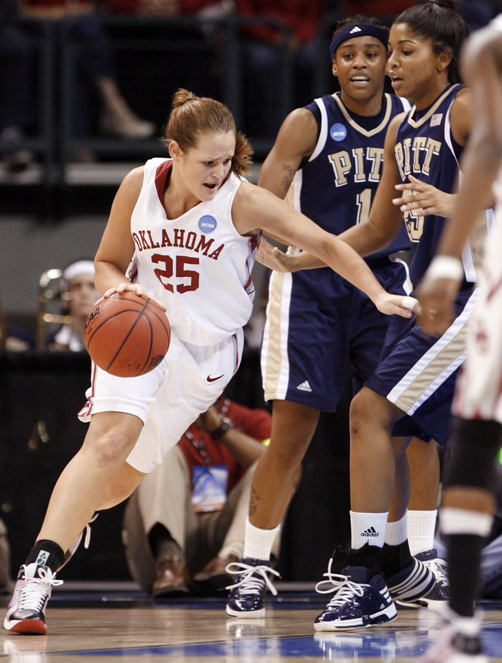 Photo - Whitney Hand dribble past Pitt defenders in the first half of the NCAA women's basketball tournament game between the University of Oklahoma and Pittsburgh at the Ford Center in Oklahoma City, Okla. on Sunday, March 29, 2009. 