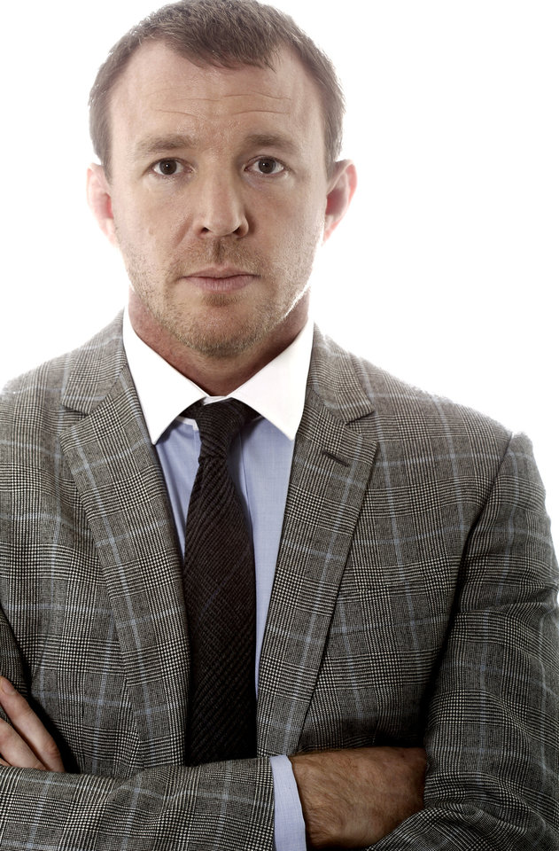 "In this Dec. 3, 2011 photo, director Guy Ritchie, from the upcoming film ""Sherlock Holmes: A Game of Shadows"", poses for a portrait in Beverly Hills, Calif., Saturday, Dec. 3, 2011. The film opens in theaters Dec. 16, 2011. (AP Photo/Matt Sayles) ORG XMIT: NYET151"