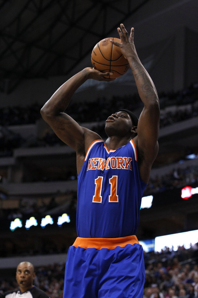 New York Knicks small forward Ronnie Brewer (11) attempts a shot against the Dallas Mavericks during an NBA basketball game Wednesday, Nov. 21, 2012, in Dallas. The Mavericks won 114-111. (AP Photo/Tony Gutierrez)