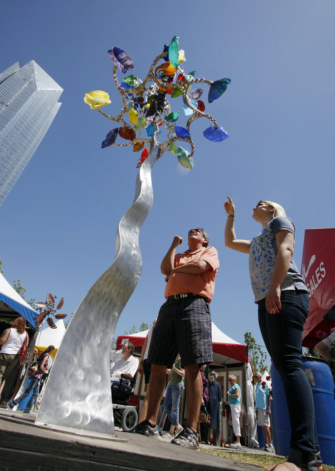 "Rick Lutz, Oklahoma City, and his niece Sarah Johnson, Montclair, New Jersey, look at Andrew Carson's kinetic sculpture entitled ""The Glassinator"" at the Oklahoma City Festival of the Arts on Friday, April 27, 2012, in Oklahoma City, Okla.  Photo by Steve Sisney, The Oklahoman"