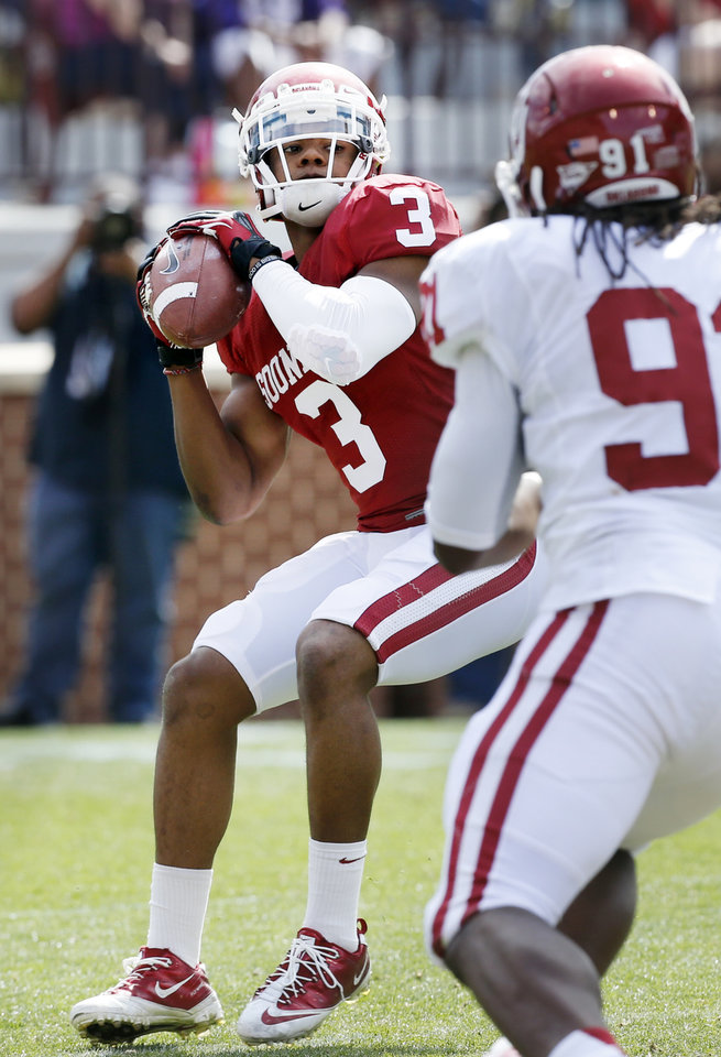 Photo - Sterling Shepard (3) launches a pass after an end around reverse on offense during the annual Spring Football Game at Gaylord Family-Oklahoma Memorial Stadium in Norman, Okla., on Saturday, April 13, 2013. the pass was icomplete.  Photo by Steve Sisney, The Oklahoman