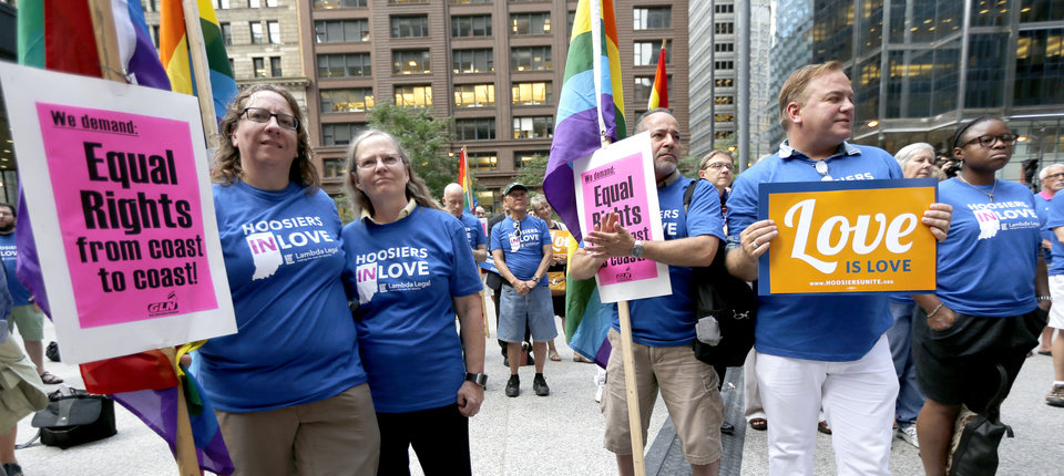 Photo - Supporters of gay marriage in Wisconsin and Indiana attend a rally at the federal plaza Monday, Aug. 25, 2014, in Chicago. The Chicago-based 7th U.S. Circuit Court of Appeals will hear arguments Tuesday on gay marriage fights from Indiana and Wisconsin, setting the stage for one ruling. Each case deals with whether statewide gay marriage bans violate the Constitution. (AP Photo/Charles Rex Arbogast)