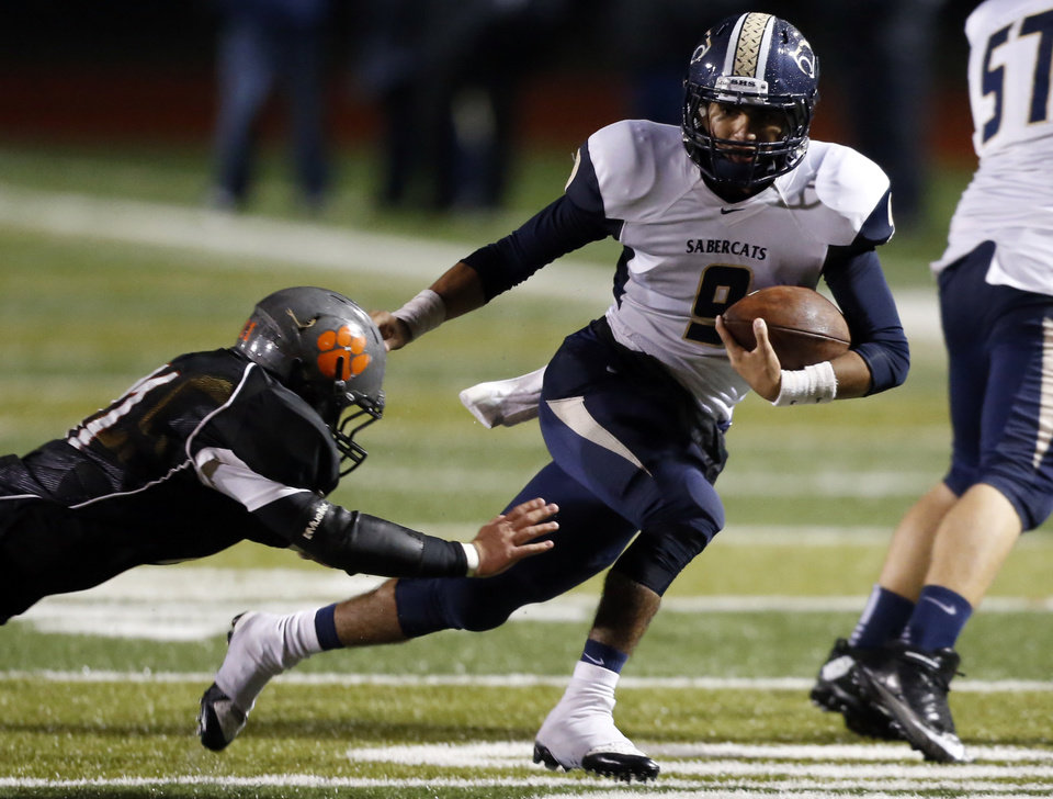 Southmoore's Gabe Garza runs as the Sabercats play Norman in high school football on Friday, Oct. 18, 2013 in Norman, Okla.  Photo by Steve Sisney, The Oklahoman