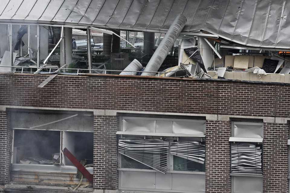 Photo - A detail of the devastation caused to a building in Oslo, Norway, after a powerful blast tore open several buildings, Friday July 22, 2011.  A loud explosion shattered windows Friday in several building including the government headquarters in Oslo which includes the prime minister's office, injuring several people.  Prime Minister Jens Stoltenberg is safe, government spokeswoman Camilla Ryste told The Associated Press. (AP PHOTO / Holm Morten, Scanpix) NORWAY OUT  ORG XMIT: LON817