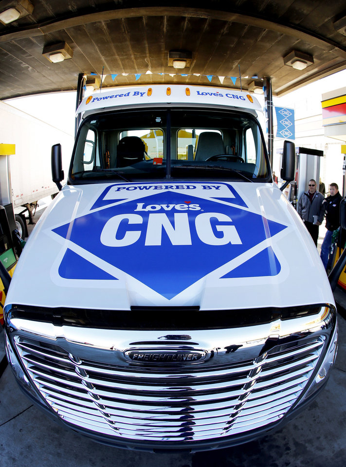 "A Gemini Motor Transport truck is filled with compressed natural gas Monday during the opening of Love's Travel Stops first ""fast fill"" CNG facility for heavy-duty trucks at Interstate 40 and Morgan Road in Oklahoma City. Photo By Steve Gooch, The Oklahoman <strong>Steve Gooch</strong>"