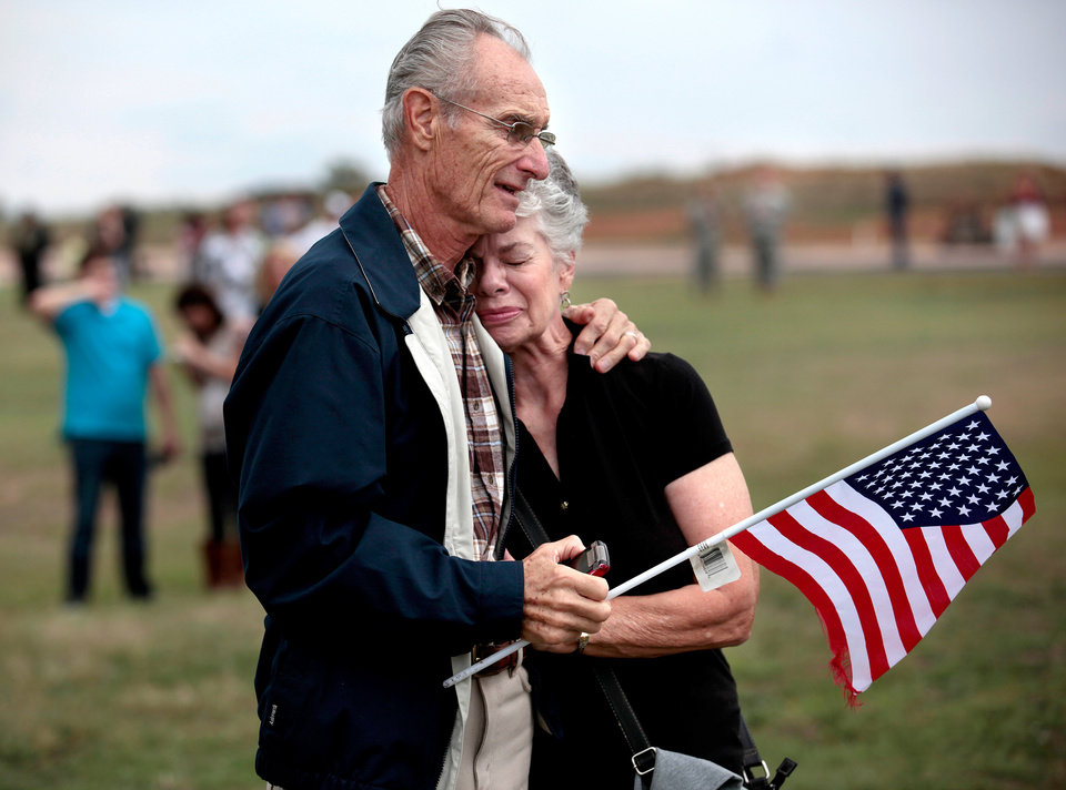 Ed and Nancy Pindel embrace after watching their son, Staff Sgt. Richard Pindel, leave in a helicopter following the  Oklahoma Aviation Command mobilization ceremony  for Detachment 1, Company C, 2-149th General Support Aviation Battalion at the Army Aviation Support Facility in Lexington, Okla., Sunday, Sept. 16, 2012. The soldiers will receive additional training at Fort Hood before being deployed to Afghanistan. Photo by Sarah Phipps, The Oklahoman