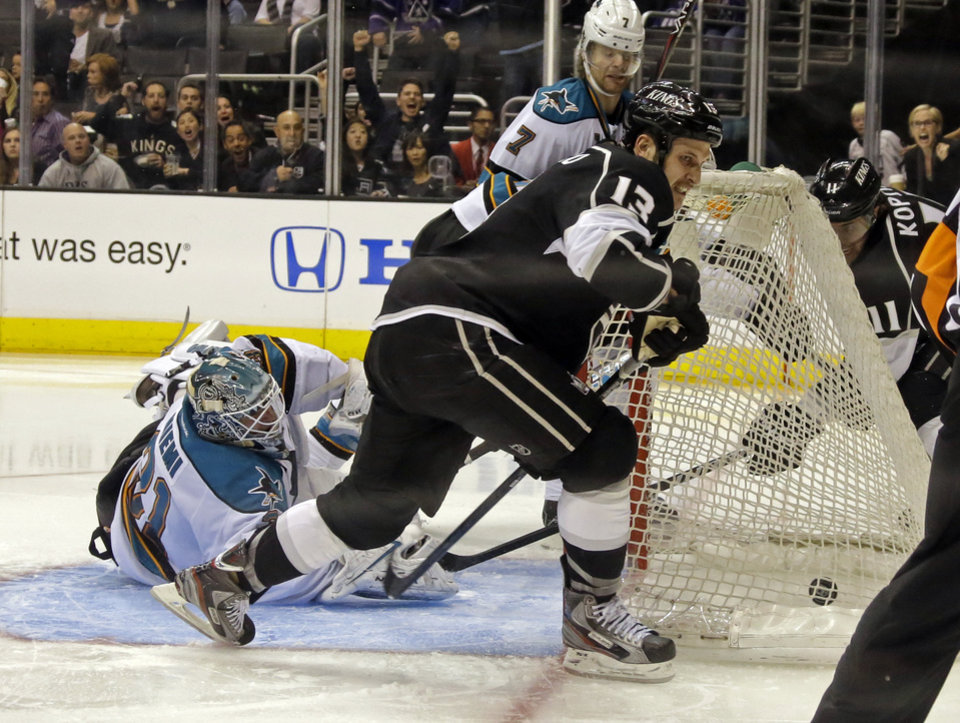 Photo - San Jose Sharks goalie Antti Niemi, of Finland, can't block a goal by Los Angeles Kings left wing Dustin Penner, not shown, with Los Angeles Kings left wing Kyle Clifford (13) in the foreground in the second period of an NHL hockey game in Los Angeles Saturday, April 27, 2013. (AP Photo/Reed Saxon)