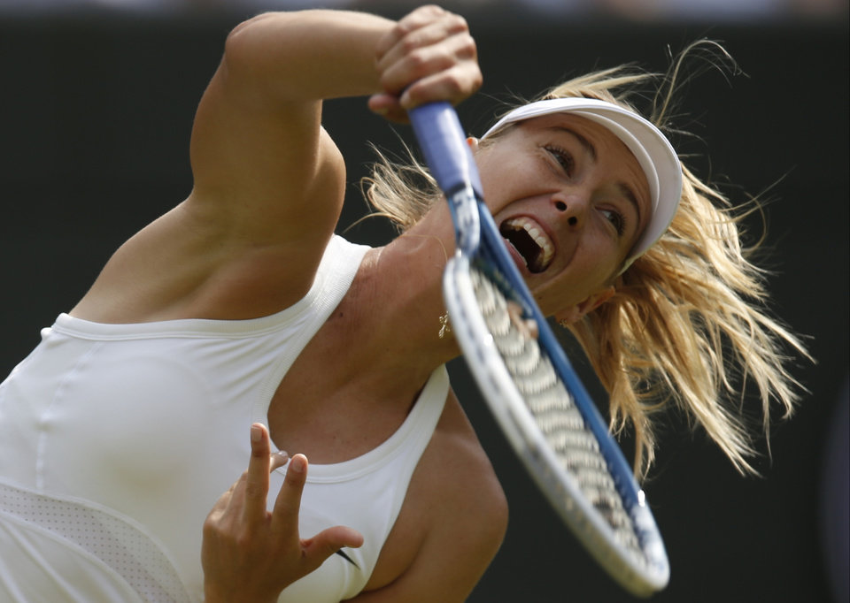 Photo - Maria Sharapova of Russia serves  to Samantha Murray of Britain during their first round match at the All England Lawn Tennis Championships in Wimbledon, London,  Tuesday, June  24, 2014. (AP Photo/Pavel Golovkin)