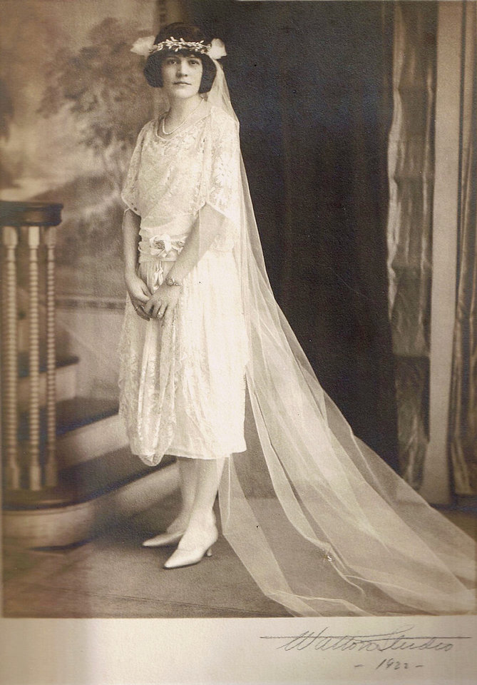 Photo - Knee-length wedding dresses made the first appearance in the 1920s. It was also traditional for veils to be secured under wax flowers. In 1922, when Edna Wagner Dierker married her husband, her dress had both features. Dierker's dress also had a drop waist, which allowed for free and loose waist definition. Photo provided by Pat Kearney