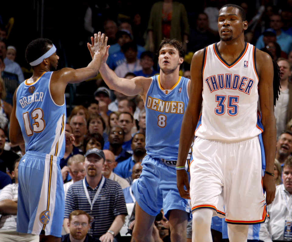 Photo - Denver's Danilo Gallinari (8) and Corey Brewer (13) celebrate beside Oklahoma City's Kevin Durant during the NBA basketball game between the Oklahoma City Thunder and the Denver Nuggets at Chesapeake Energy Arena in Oklahoma City, Wednesday, April 25, 2012. Oklahoma City lost 106-101.  Photo by Bryan Terry, The Oklahoman