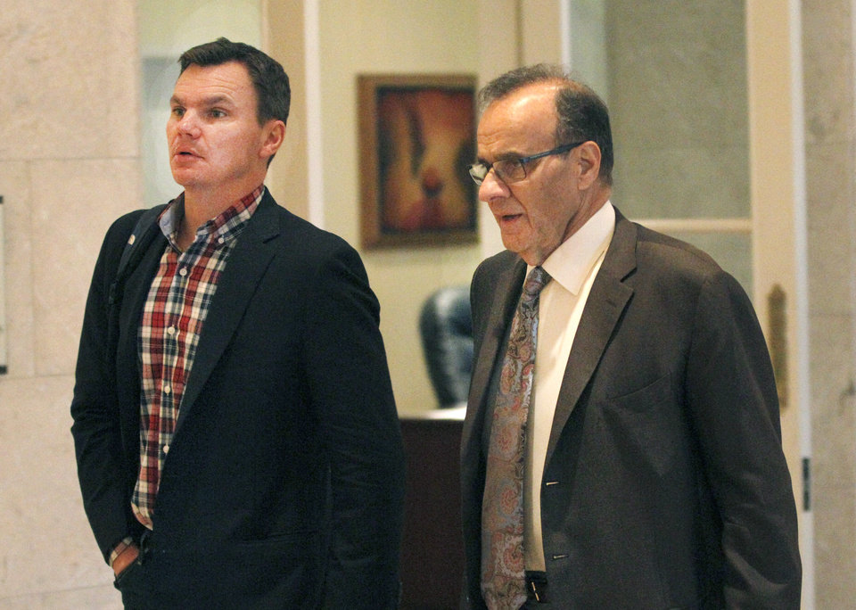 Photo - Major League Baseball executive Joe Torre, right, and Boston Red Sox general manager Ben Cherington talk in the hallway at the annual general managers meeting Tuesday, Nov. 12, 2013, in Orlando, Fla. (AP Photo/Reinhold Matay)