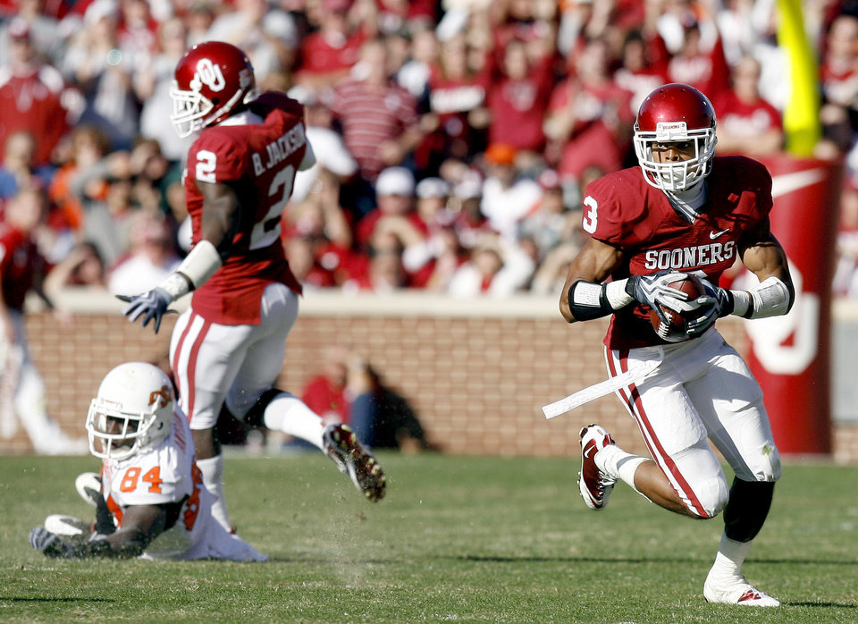 Photo - OU's Jonathan Nelson (3) intercepts a Zac Robinson pass intended for OSU's Hubert Anyiam (84) during the second half of the Bedlam college football game between the University of Oklahoma Sooners (OU) and the Oklahoma State University Cowboys (OSU) at the Gaylord Family-Oklahoma Memorial Stadium on Saturday, Nov. 28, 2009, in Norman, Okla. Photo by Sarah Phipps, The Oklahoman
