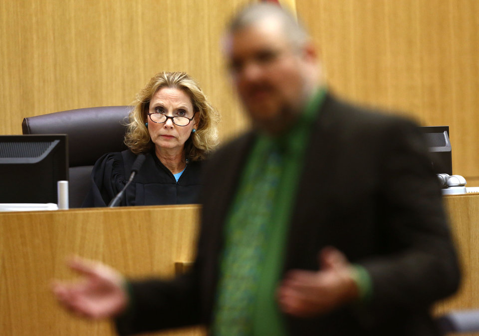 Photo - Judge Sherry Stephens listens to defense attorney Kirk Nurmi address the jury on Wednesday, May 15, 2013, during the sentencing phase of the Jodi Arias murder trial at Maricopa County Superior Court in Phoenix. If the jury finds aggravating factors in her crime, Arias could be sentenced to death.   (AP Photo/The Arizona Republic, Rob Schumacher, Pool)
