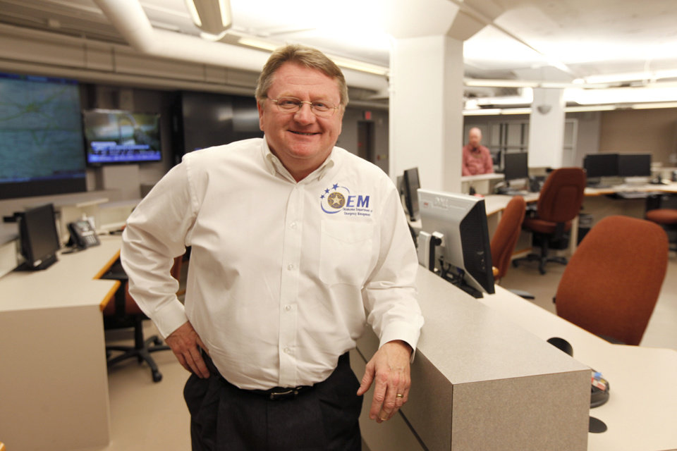 Photo - Albert Ashwood, the Oklahoma Department of Emergency Management director, is shown in the Emergency Operations Center in Oklahoma City.  PAUL HELLSTERN - Paul Hellstern, The Oklahoman