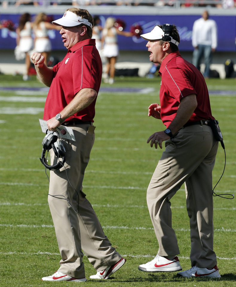 Photo - Defensive coordinator Mike Stoops and head coach Bob Stoops yell to the defense in the final minutes of the second half of the college football game where the University of Oklahoma Sooners (OU) defeated the Texas Christian University Horned Frogs (TCU) 24-17 at Amon G. Carter Stadium in Fort Worth, Texas, on Saturday, Dec. 1, 2012. Photo by Steve Sisney, The Oklahoman