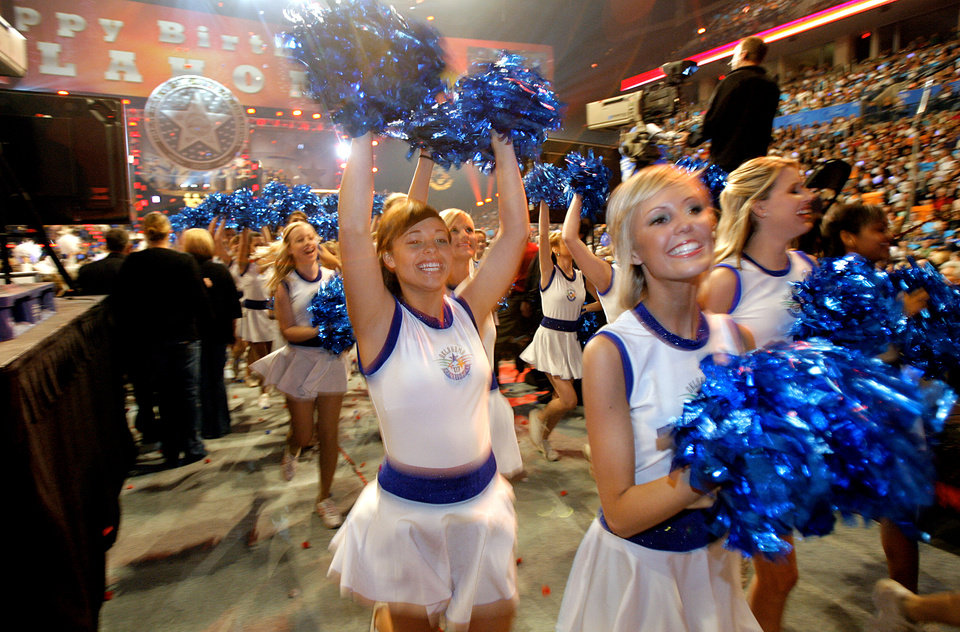 Photo - The Oklahoma Centennial cheer squad leaves the floor during the Centennial Spectacular to celebrate the 100th birthday of the State of Oklahoma at the Ford Center on Friday, Nov. 16, 2007, in Oklahoma City, Okla. Photo By CHRIS LANDSBERGER, The Oklahoman