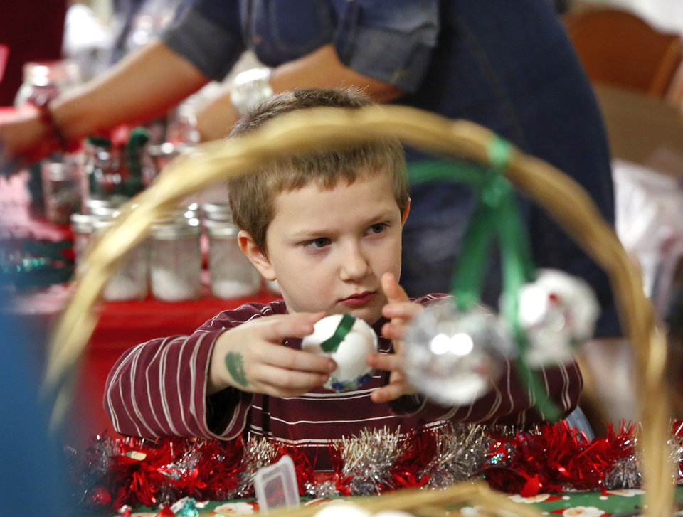 CHILD / KIDS: Daryn, 7, makes a Christmas ornament. Oklahoma Rep. Joe Dorman served lunch at the annual holiday carnival for parents and children at Positive Tomorrows ,  a school for homeless children in Oklahoma City on Tuesday, Dec. 18, 2012.  More than 30 volunteers, representing various civic organizations, businesses and churches,  helped at the event, sponsoring a wide variety of games and activities for the children. Photo by Jim Beckel, The Oklahoman