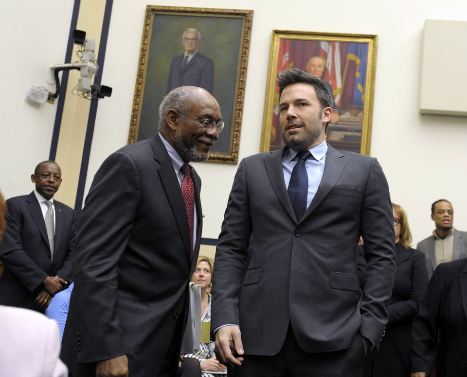 Photo - Ben Affleck, actor and founder of the Eastern Congo Initiative, right, talks with Johnnie Carson, Assistant Secretary of State for the Bureau of African Affairs, left, before testifying before the House Armed Services Committee on the evolving security situation in the Democratic Republic of the Congo during a hearing on Capitol Hill in Washington, Wednesday, Dec. 19, 2012. (AP Photo/Susan Walsh)