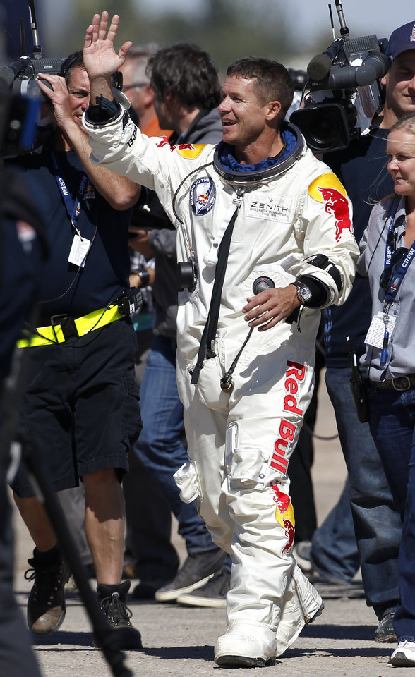 Felix Baumgartner, of Austria, waves to Mission Control staff, family, and friends after successfully jumping from a space capsule lifted by a helium balloon at a height of just over 128,000 feet above the Earth's surface, Sunday, Oct. 14, 2012, in Roswell, N.M. Baumgartner landed in the eastern New Mexico desert minutes after jumping from his capsule 28,000 feet (8,534 meters), or 24 miles (38.6-kilometer), above Earth. (AP Photo/Ross D. Franklin) ORG XMIT: NMRF117