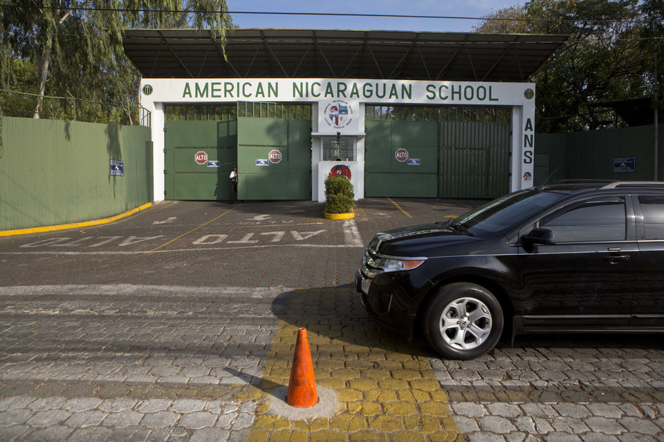 Photo - In this Wednesday, May 7, 2014 photo, a vehicle drives by the main entrance gate of the American Nicaraguan School in Managua, Nicaragua. U.S. citizen William James Vahey, 64, worked as teacher here from 2013-2014. He was one of the most beloved teachers in the world of international schools that serve the children of diplomats, well-off Americans and local elites. The FBI regards Vahey as one of the most prolific pedophiles in memory has set off a crisis in the community of international schools, where parents are being told that their children may have been victims, and administrators are scurrying to close loopholes exposed by Vahey's abuses. (AP Photo/Esteban Felix)