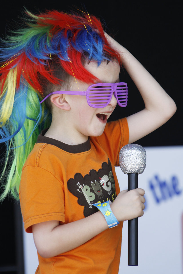 Photo - Spenser Little (CQ SPENSER) , 7, pretends to be a rock star during the Festival of the Child at Yukon City Park  Saturday, May 7, 2011.  Photo by Doug Hoke, The Oklahoman. ORG XMIT: KOD ORG XMIT: OKC1105091108577810 ORG XMIT: 1107191959134108