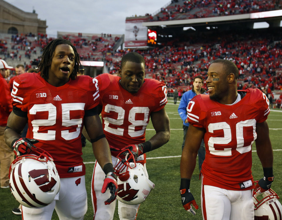 Photo -   Wisconsin running backs Melvin Gordon (25), Montee Ball and James White exit the field after their 31-14 win over Illinois in an NCAA college football game on Saturday, Oct. 6, 2012, in Madison, Wis. (AP Photo/Andy Manis)