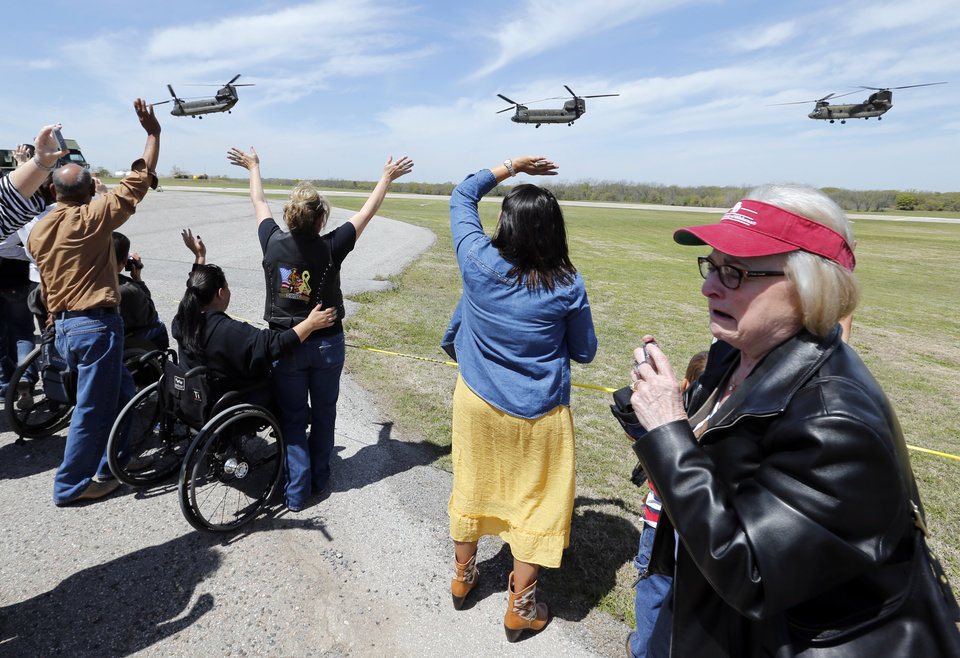 Barbara McGuckin, right, from Norman, wipes a tear as family members wave to departing servicemen after a deployment ceremony for the 149th General Support Aviation Battalion (GSAB), as they prepare for deployment to Afghanistan in support of Operation Enduring Freedom on Thursday, April 25, 2013 in Lexington, Okla. McGuckin's grandson Kelly Fisher is part of the deployment.  Photo by Steve Sisney, The Oklahoman