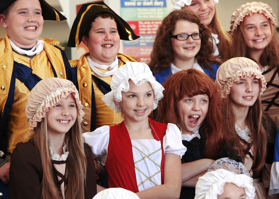 Right: Students in costume pose for a group picture for the school�s yearbook. Photos by Jim Beckel, The Oklahoman