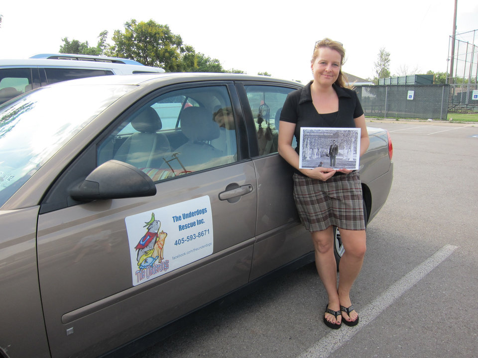 Photo -  Meike Parker, co-founder of The Underdogs Rescue Inc., holds one of the organization's new 2014-2015 calendars. The calendars are being sold to raise funds for the fledgling rescue group. Photo by Carla Hinton, The Oklahoman