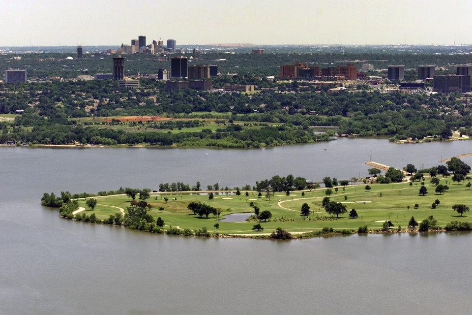 OKLAHOMA CITY / SKYLINE / AERIAL VIEW: Lake Hefner provides water to Oklahoma City.  The Downtown skyline is top left on the horizon in this aerial view of Oklahoma City.  Staff photo by Steve Sisney.