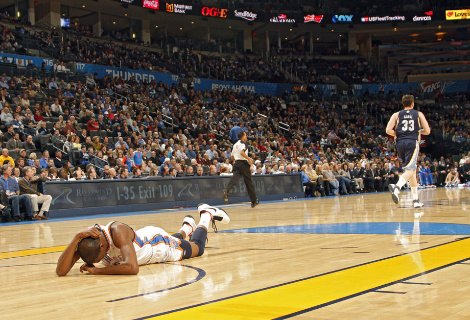 The Thunder\'s Kevin Durant lies on the court in pain after hitting his head during the NBA basketball game between the Oklahoma City Thunder and the Memphis Grizzlies at the Oklahoma City Arena on Tuesday, Feb. 8, 2011, Oklahoma City, Okla. Photo by Chris Landsberger, The Oklahoman