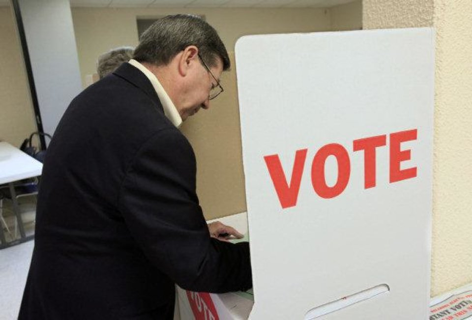 Attorney General Drew Edmondson, gubernatorial candidate, marks his ballot in the voting booths at precinct 574, Sooner and Hefner roads in northeast Oklahoma City Tuesday. PAUL B. SOUTHERLAND - PAUL B. SOUTHERLAND