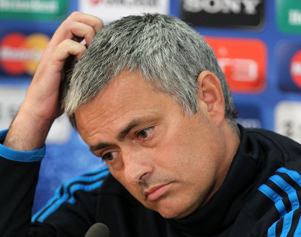 FILE -  This is a Monday, March 26, 2012 file photo of Real Madrid's coach Jose Mourinho of Portugal  as he reacts during a news conference at GSP stadium in Nicosia. Real Madrid says Monday May 20, 2013, coach Jose Mourinho will leave at end of season. (AP Photo/Thanassis Stavrakis)