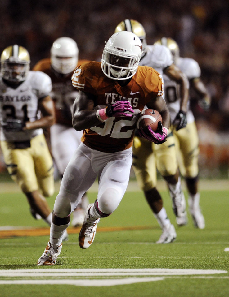 Photo -   Texas running back Johnathan Gray (32) scores a touchdown during the second quarter of an NCAA college football game against Baylor, Saturday, Oct. 20, 2012, in Austin, Texas. (AP Photo,The Daily Texan, Elisabeth Dillon)