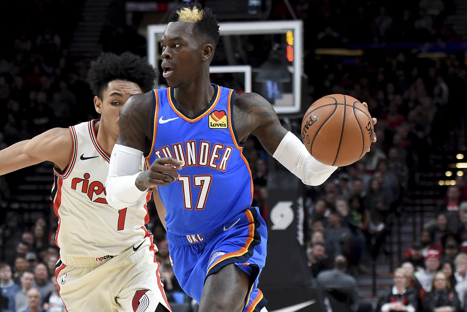 Photo - Oklahoma City Thunder guard Dennis Schroder, right, drives to the basket on Portland Trail Blazers guard Anfernee Simons, left, during the first quarter of an NBA basketball game in Portland, Ore., Wednesday, Nov. 27, 2019. (AP Photo/Steve Dykes)