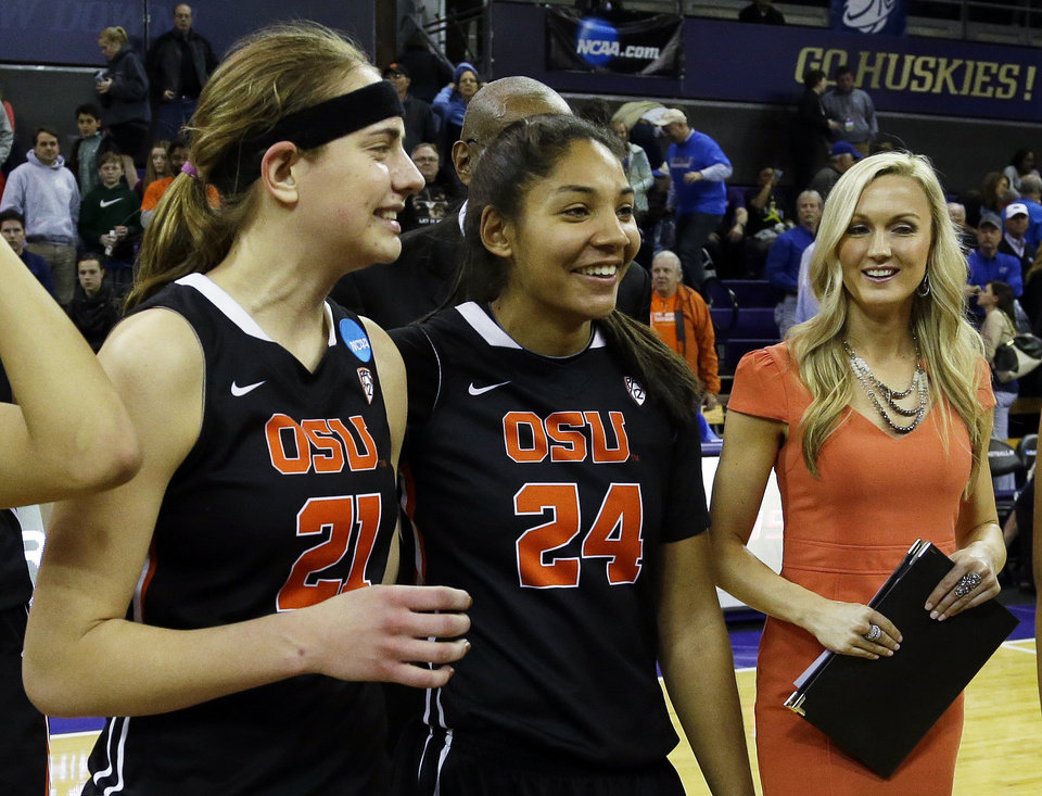 Photo - Oregon State's Sydney Wiese (21) and Alyssa Martin (24) walk off the court with assistant coach Mandy Close, right, after OSU beat Middle Tennessee State 55-36 in a first-round game in the NCAA women's college basketball tournament, Sunday, March 23, 2014, in Seattle. (AP Photo/Ted S. Warren)