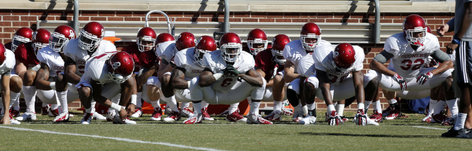 Photo - The University of Oklahoma Sooners (OU) begin spring practice on Owen Field at Gaylord Family-Oklahoma Memorial Stadium in Norman, Okla., on Tuesday, March 11, 2014. Photo by Steve Sisney, The Oklahoman