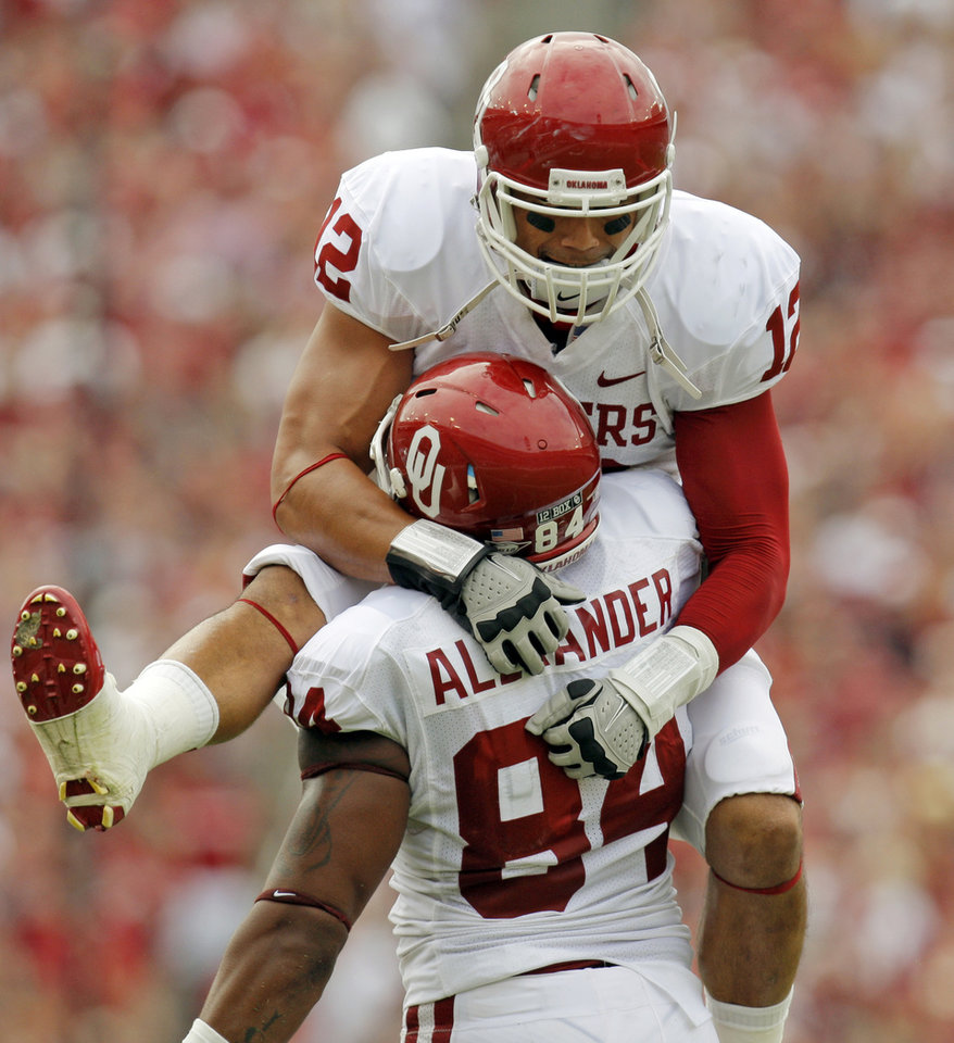 Photo - OU's Travis Lewis (12) and Frank Alexander (84) celebrate a recovery of a Texas fumble in the first half during the Red River Rivalry college football game between the University of Oklahoma Sooners (OU) and the University of Texas Longhorns (UT) at the Cotton Bowl in Dallas, Friday, Oct. 7, 2011. Photo by Nate Billings, The Oklahoman