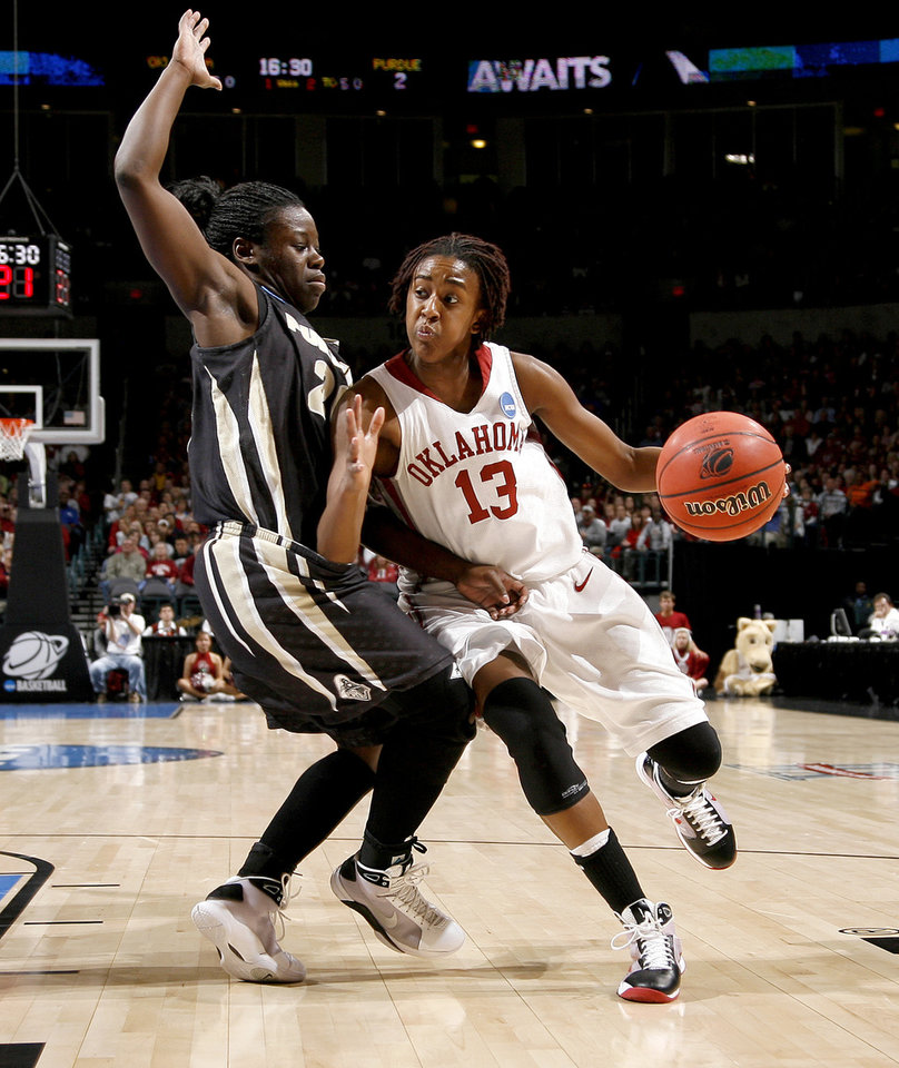 Photo - OU's Danielle Robinson goes around Purdue's FahKara Malone during the NCAA women's basketball regional  tournament finals between Oklahoma and Purdue at the Ford Center in Oklahoma City, Tuesday, March 31, 2009.  Photo by Bryan Terry, The Oklahoman