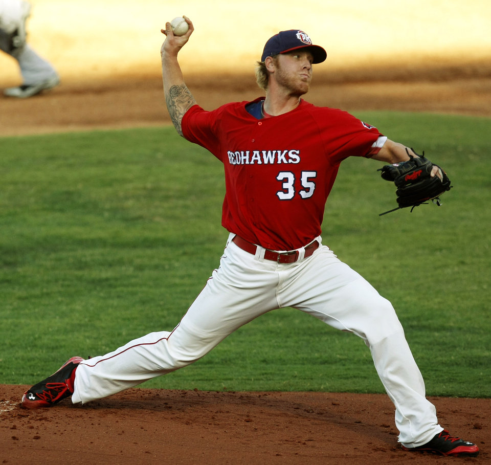 Photo - Redhawks starting pitcher Mike Foltynewwicz (35) throws a pitch during a minor league baseball game between the New Orleans Zephyrs and the Oklahoma City Redhawks at the Chickasaw Bricktown Ballpark on July 7, 2014 in downtown Oklahoma City. Photo by KT King/The Oklahoman