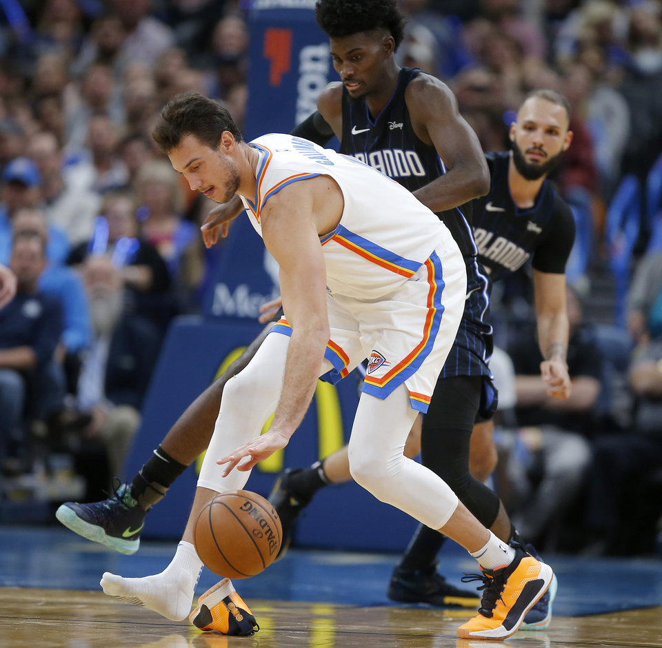 Photo - Oklahoma City's Danilo Gallinari (8) dribbles over his shoe after losing it infront of Orlando's Jonathan Isaac (1) during an NBA basketball game between the Oklahoma City Thunder and the Orlando Magic at Chesapeake Energy Arena in Oklahoma City, Tuesday, Nov. 5, 2019. Oklahoma City won 102-94. [Bryan Terry/The Oklahoman]