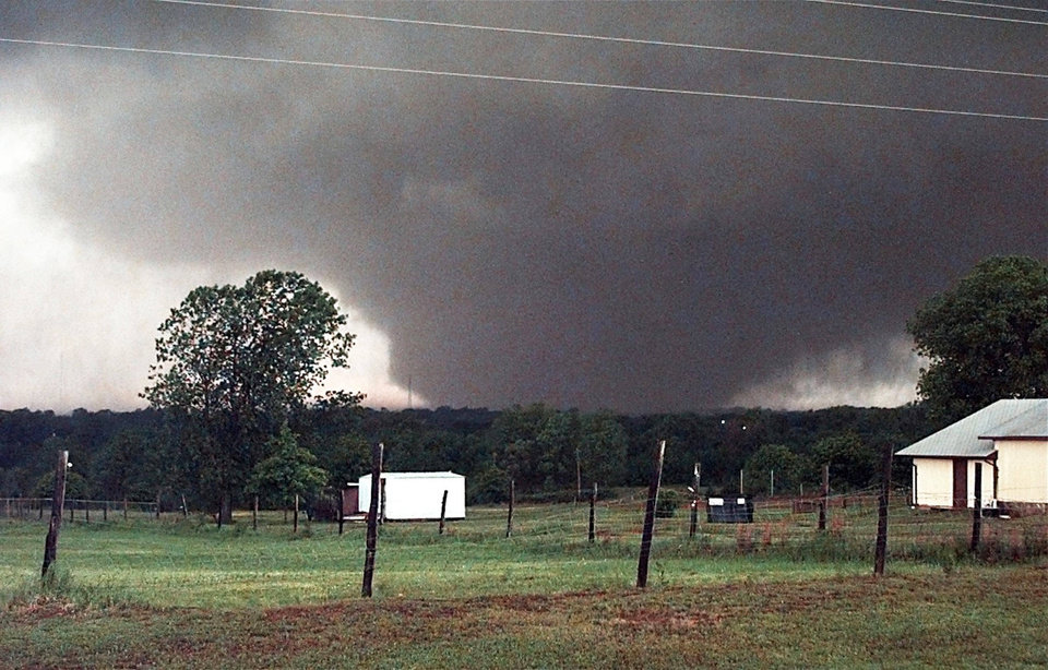 Photo - May 3, 1999 Oklahoma City Tornado:  A  tornado on the ground over 1 1/2 miles wide looking west to Amber from state highway 76 and south of SH 130.  Staff Photo by Paul B. Southerland