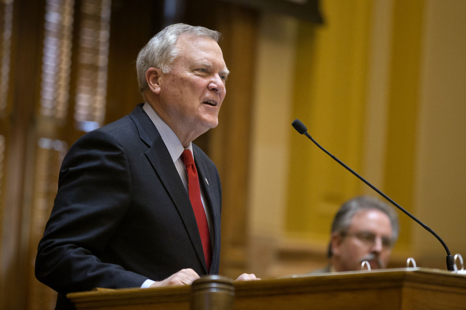 Photo - FILE – In this March 28, 2013, file photo Republican Governor of Georgia Nathan Deal addresses the Senate in Atlanta. As more Republican governors yield to President Barack Obama's health care overhaul, an opposition bloc remains across the most conservative states in South, which includes governors who lead some of the nation's poorest and unhealthiest states.  Among them is Deal, who answers with skepticism when asked about projected uncompensated care savings and the U.S. Congress's pledge to finance 90 percent of new Medicaid costs. (AP Photo/David Goldman, File)