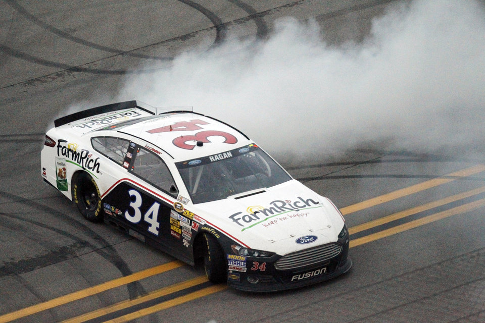 Photo - David Ragan burns out his tires following a win in the NASCAR Sprint Cup Series Aaron's 499 auto race at Talladega Superspeedway in Talladega, Ala., Sunday, May 5, 2013. (AP Photo/Butch Dill)