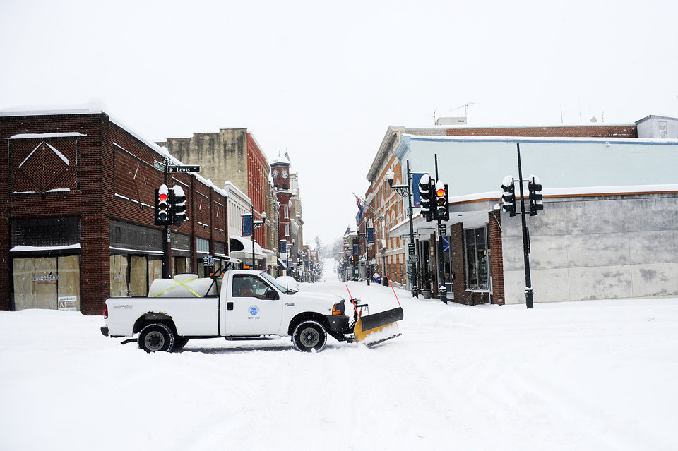 Photo - A City of Staunton snowplow drives along Lewis Street after a snowstorm accumulating over a foot of snow on Thursday, Feb. 13, 2014, in Staunton, Va. (AP Photo/The News Leader, Katie Currid)