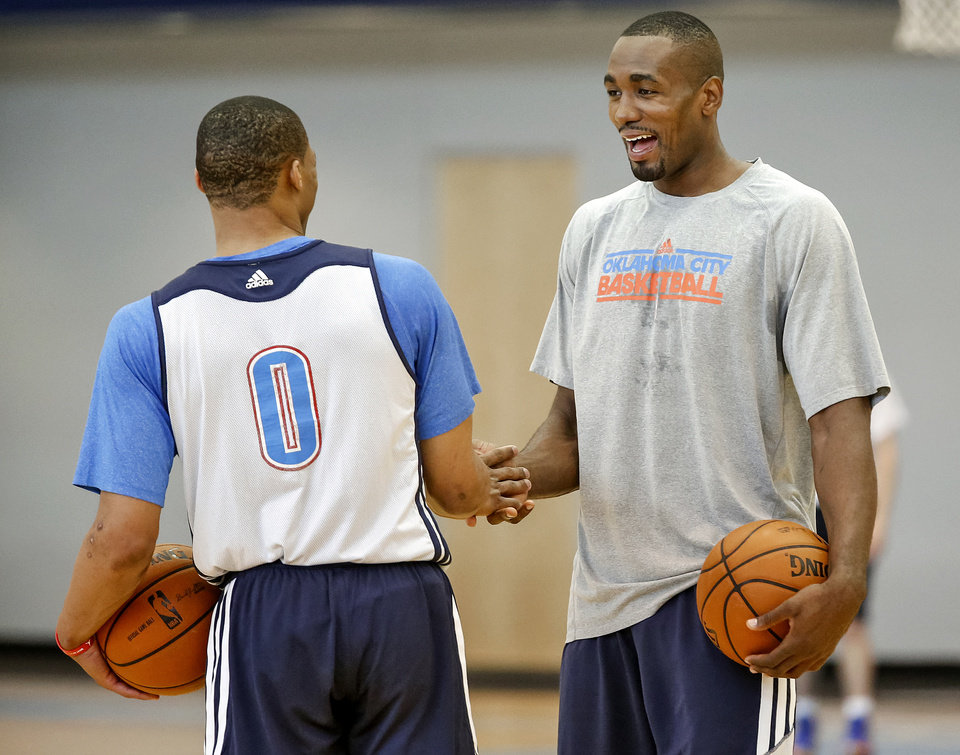 Photo - Russell Westbrook and Serge Ibaka talk as they finish up practice during the Oklahoma City Thunder media availability at the Thunder practice facility in Oklahoma City, Okla. on Monday, May 12, 2014.   Photo by Chris Landsberger, The Oklahoman