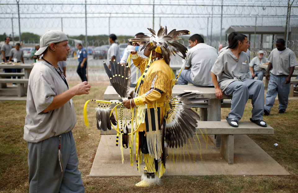 Photo - Inmate David Arkinson, a Sioux, stands with other inmates during a break for a count in the 27th Annual Confined Inter-Tribal Group Gourd Dance & Pow-Wow inside Joseph Harp Correctional Center in Lexington, Okla., on Friday, September 9, 2016. Photo by Bryan Terry, The Oklahoman